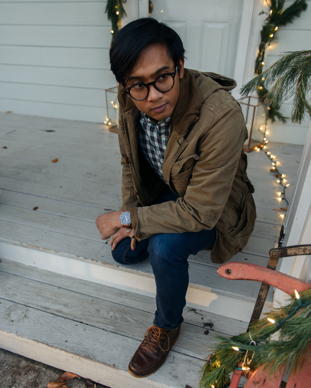 male wearing fossil watch and flannel shirt