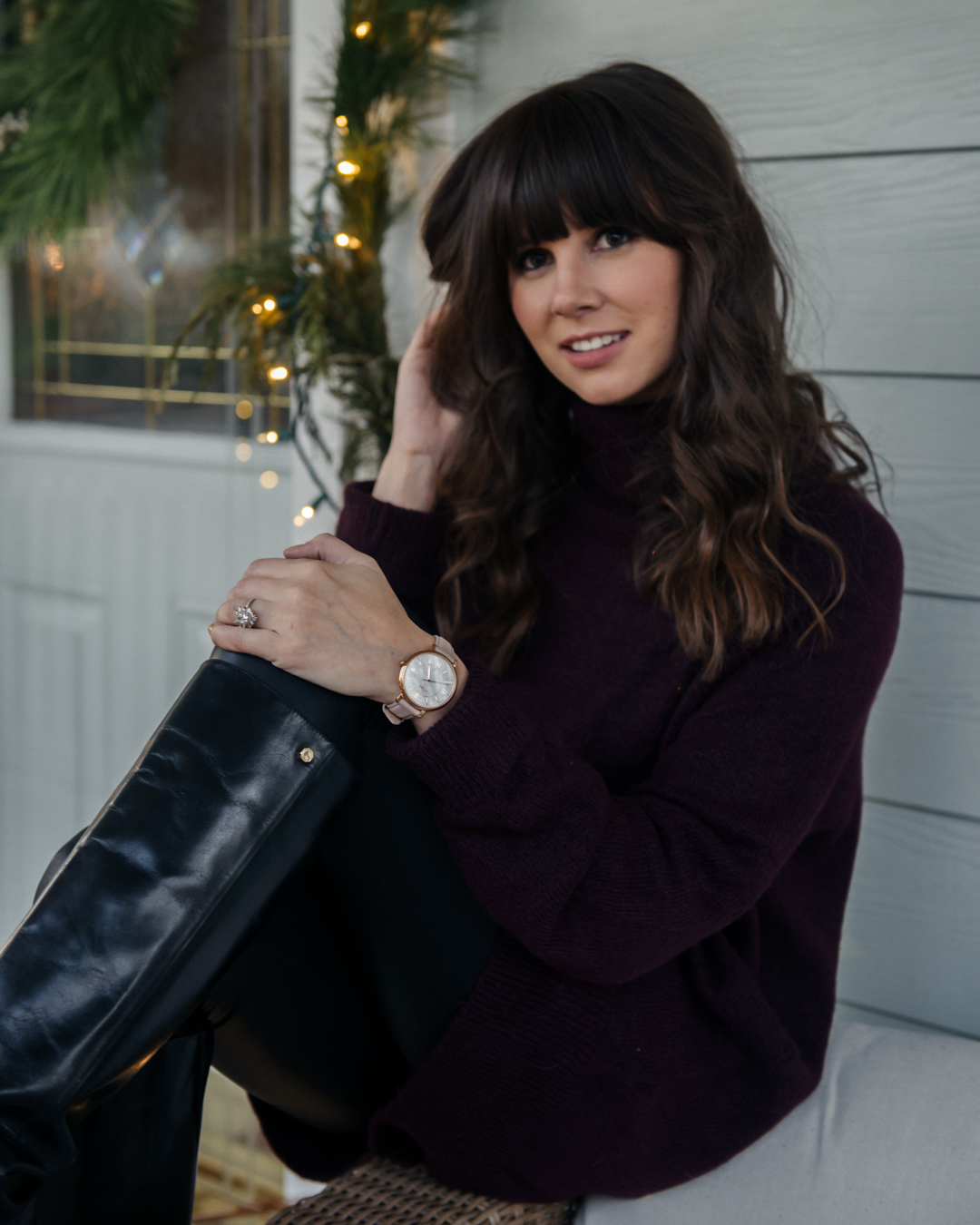 fashion photo featuring leather boots and fossil watch